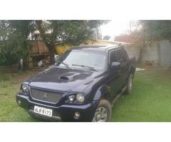 vendo ou troco L200 4x4 esporte,diesel completa 2004.